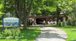 The Camp Sunshine building on Ward's Island on a beautiful summer day.
